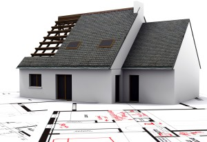 House mockup on top of blueprints with red pen notes and corrections